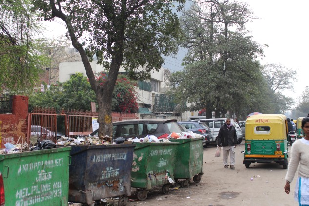 all pedestrian space occupied by garbage bins